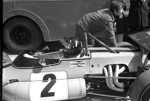 Graham Hill in a Brabham BT36 Cosworth FVA being pushed out of the paddock before the race.