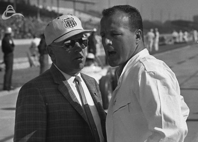 A.J. explains something to a USAC official, 1963. (Johnson)