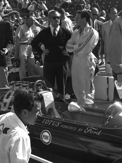 Colin Chapman and Jim Clark chit chat in the pits, 1963. (Johnson)