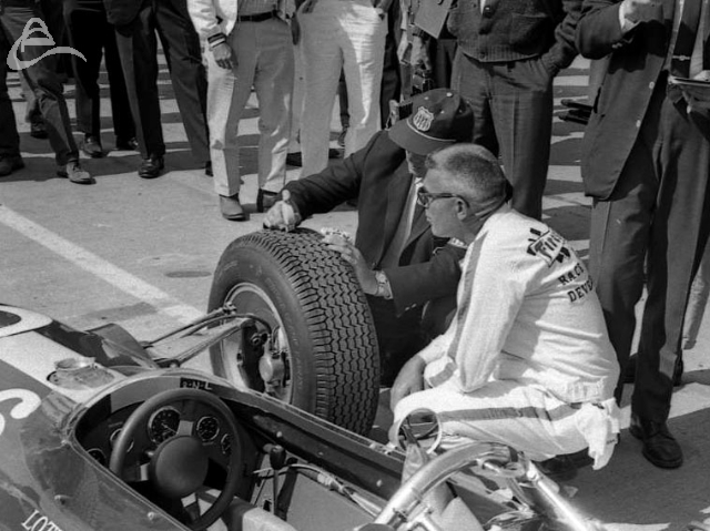 Jim Clark's Lotus goes through a USAC tech inspection, 1964. (Johnson)