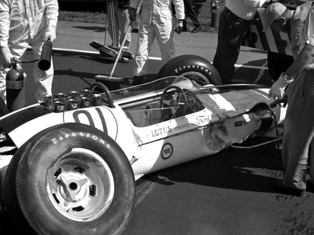 Gurney's Lotus after a brush with the wall, 1963. (Johnson)