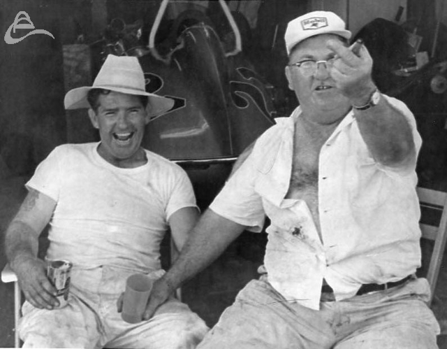 We got garage passes and beer! We're number one! Happy hour at IMS in front of Elmer George's garage, 1962. (Johnson)