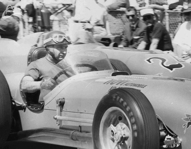 Formula 1 legend Juan Fangio pulls out of pits for a test run in the Novi, Indy, 1958. (UPI)