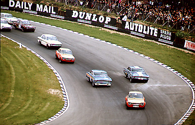 Saloon car racing in the 60's produced the David and Goliath battles between the American Ford Galaxies, Falcons and Mustangs against Ford Escorts, Lotus Cortinas and Mini Coopers. Paddock Hill bend at Brands Hatch was always fast and furious on the first lap.