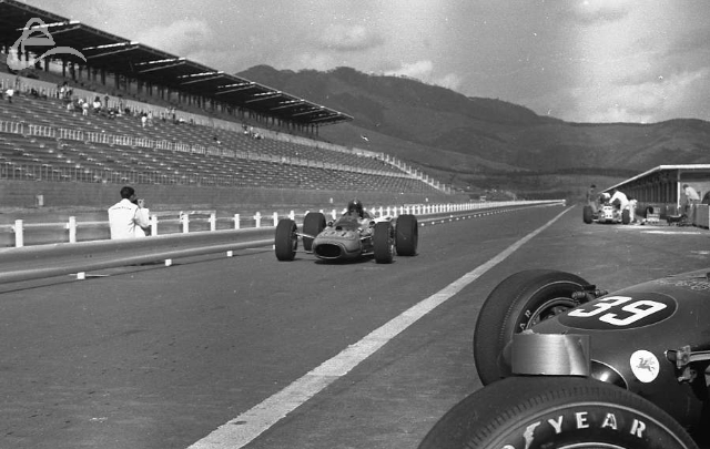 Fuji, 1966. Bill Cheesbourg pits during practice. (Johnson)