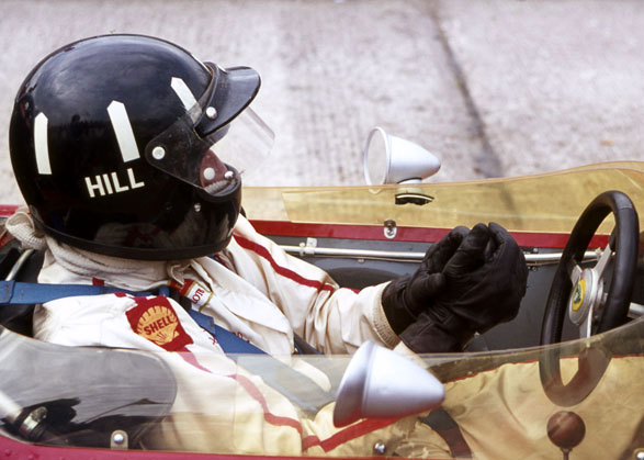 Graham Hill in the pits with the Gold Leaf Team Lotus.