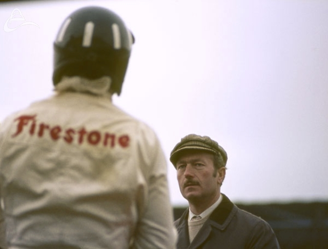 Graham Hill chats with Colin Chapman Silverstone 1969. Photograph © Roger Lane