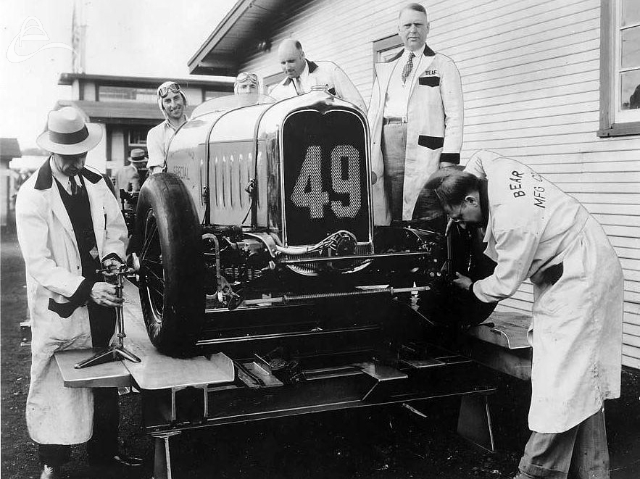 The first Bear rack to appear at IMS, 1931. Checking camber and toe-in on driver Harry Butcher's Indy ride. (Bear Mfg. Co.)