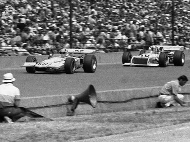 Mike Hiss and Johnny Rutherford roar down the front straight, 1972. (Johnson)
