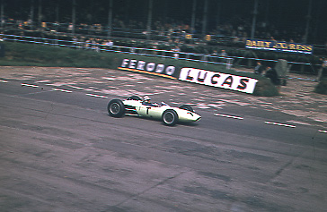 This was probably one of my first motor racing photographs taken during practice for the British GP of 1964. This image depicts the infamous Innes Ireland in the British Racing Partnership car exiting Woodcote corner in front of the pits.