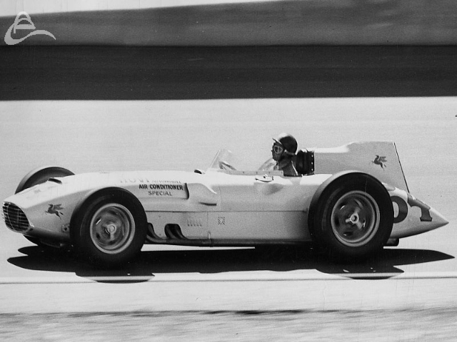 Juan Fangio at speed, Indy, 1958. (Photographer Unknown)