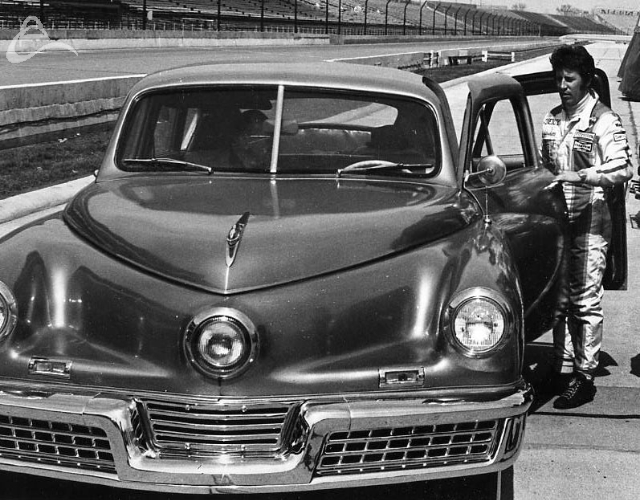 Mario Andretti and a 1947 Tucker. Photo could be from 1972 through 1975. (Photographer Unknown)