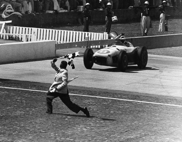 Pat Flaherty takes the checkered flag at Indy, 1956