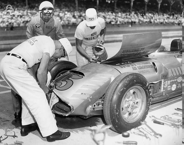 Paul Russo's team inspects the damage after a crash in the 1958 Indy 500. (Photographer Unknown)