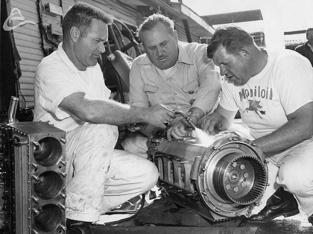 Rebuilding an Offy. Bud Wheeler, Bob Clidinst, Jack Miller. (Oates)