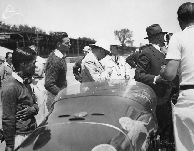 Rex Mays (2nd from left) after winning the pole for the 1935 Indy 500. (Copps)