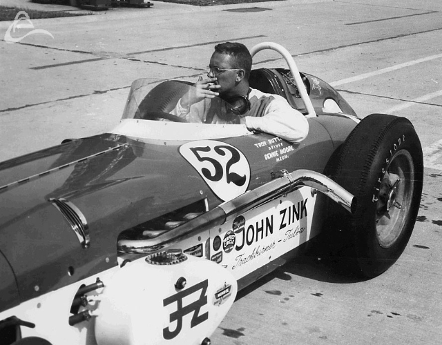Troy Ruttman taking a smoke break at Indy, 1961. (Johnson)
