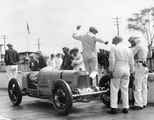 1928. Wilbur Shaw qualified Pete DePaolo's #1 Flying Cloud Special on race day morning after DePaolo's fourth turn practice crack-up. Pete watched the race from a stretcher in the pits. Wilbur retired from the race after only 42 laps due to a failed timing gear.(Photographer Unknown)