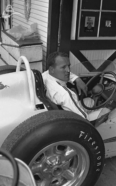 A.J. Foyt takes it to the garage, 1962. (Johnson)